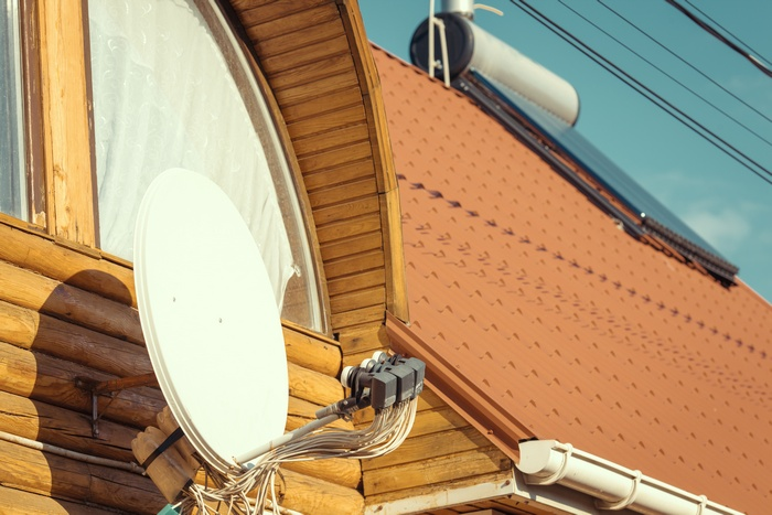 satellite dish and tv antenna on a sunny day